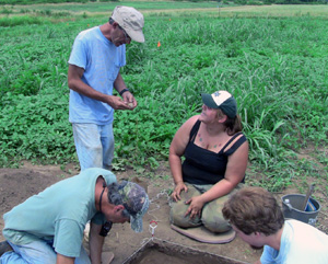 The MU Archaeological Fieldschool's Director, Dr. Nicholas Freidin, is shown assisting Autumn Crank--now a graduate of the Anthropology Program pursuing her Masters degree.
