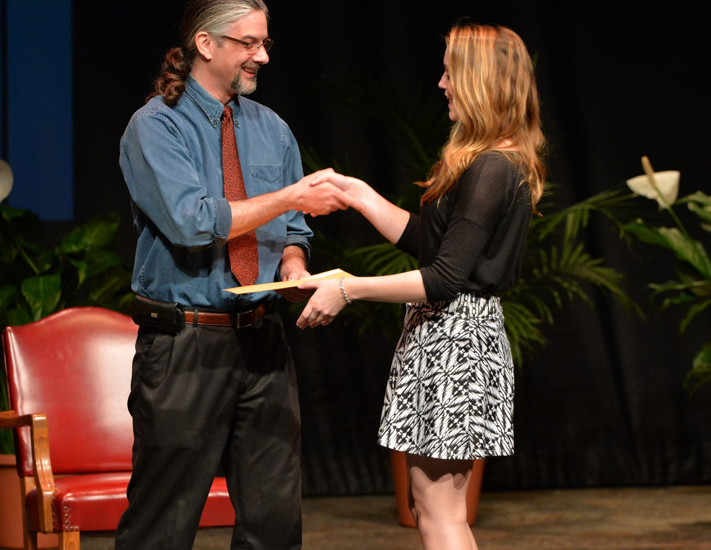 Dr. Brian A. Hoey (Anthropology) presents an award to program major Clarissa Bonnefond at the 2015 Honors Convocation