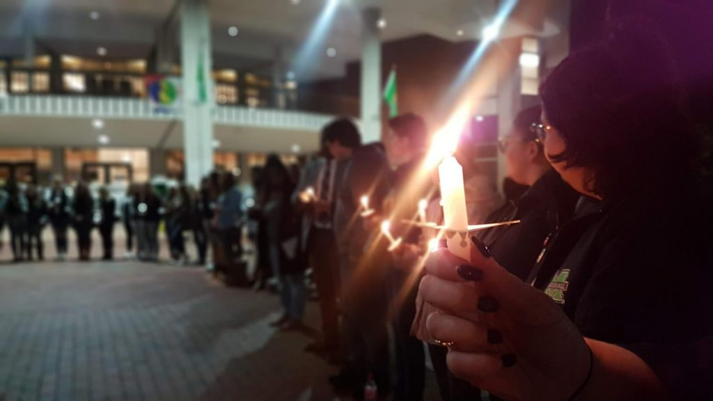 Image of students and Marshall communities members at Take Back the Night Vigil, in honor of survivors of sexual assault.